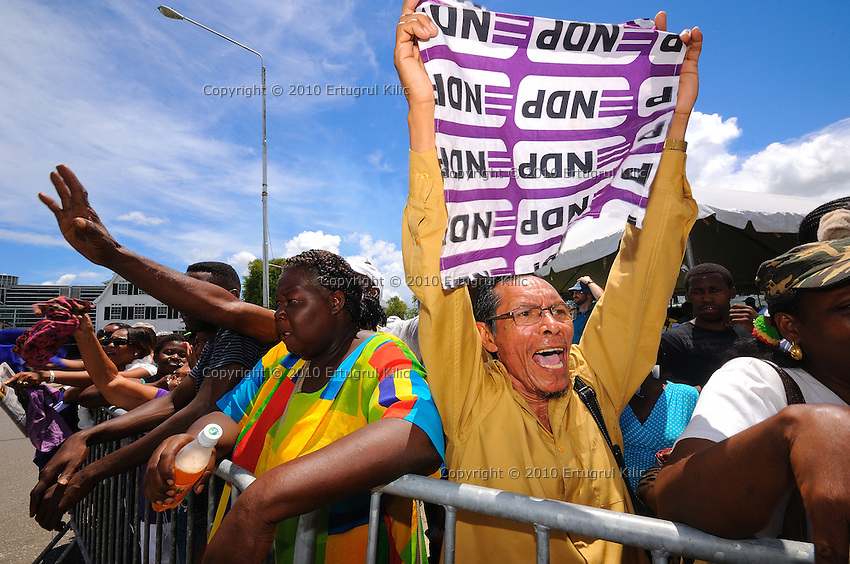 NDP (National Democratic Party of Suriname) supporters are acting at front of De Nationale Assemblée (DNA) / The National Assemble of Suriname after Desi Bouterse (Desiré Delano Bouterse) won election of presidential election...Desi Bouterse (Desiré Delano Bouterse) chosen as new president of Suriname by De Nationale Assemblée (DNA) / The National Assemble of Suriname. He took 36 votes of 51 as leader of the Mega Combination. ....Robert_Ameerali the head of KKF (Kamer van Koophandel en Fabrieken) / Chamber of Commerce and Industry also selected as Vice President.....Desi Bouterse (Desiré Delano Bouterse) will sworn at 3 August 2010
