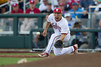 Indiana Hoosiers first baseman Sam Travis (6) records a putout against the Mississippi State Bulldogs during Game 6 of the 2013 Men's College World Series on June 17, 2013 at TD Ameritrade Park in Omaha, Nebraska. The Bulldogs defeated Hoosiers 5-4. (Andrew Woolley/Four Seam Images)