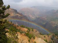 """A rainbow adorns Waimea Canyon or """"the Grand Canyon of the Pacific,"""" Kaua'i."""