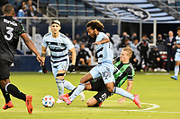 KANSAS CITY, KS - MAY 9: Gianluca Busio #10 Sporting KC tackled by Alex Ring #8 Austin FC during a game between Austin FC and Sporting Kansas City at Children's Mercy Park on May 9, 2021 in Kansas City, Kansas.