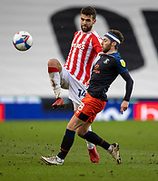 20th February 2021; Bet365 Stadium, Stoke, Staffordshire, England; English Football League Championship Football, Stoke City versus Luton Town; Tommy Smith of Stoke City is tackled by Jordan Clark of Luton Town