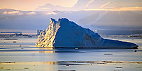 iceberg floating in McMurdo sound, Dry valleys in Backgraound, Antarctica