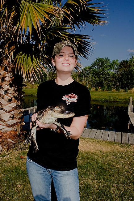 Female Staff, Baby Alligator, Black Hammock Restaurant, Ovieda near Orlando, Florida