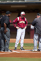 Winthrop Eagles head coach Tom Riginos (10) meets with the umpires and Kennesaw State Owls head coach Mike Sansing prior to their game at the Winthrop Ballpark on March 15, 2015 in Rock Hill, South Carolina.  The Eagles defeated the Owls 11-4.  (Brian Westerholt/Four Seam Images)