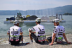 Team Qhubeka Assos admire the view as they wait to sign on before the start of Stage 20 of the 2021 Giro d'Italia, running 164km from Verbania to Valle Spluga-Alpe Motta, Italy. 29th May 2021.  <br /> Picture: LaPresse/Massimo Paolone   Cyclefile<br /> <br /> All photos usage must carry mandatory copyright credit (© Cyclefile   LaPresse/Massimo Paolone)