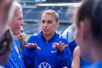 CHICAGO, IL - OCTOBER 5: Alex Morgan #13 of the United States talks in the huddle at Soldier Field on October 5, 2019 in Chicago, Illinois.