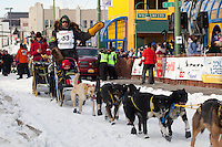 Musher Gerry Willomitzer and Iditarider Benjamin Meyer.leave the 2011 Iditarod ceremonial start line in downtown Anchorage, Alaska