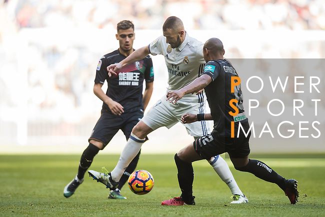 Karim Benzema (c) of Real Madrid fights for the ball with Gabriel Silva (r) of Granada CF during their La Liga match between Real Madrid and Granada CF at the Santiago Bernabeu Stadium on 07 January 2017 in Madrid, Spain. Photo by Diego Gonzalez Souto / Power Sport Images