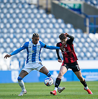 13th April 2021; The John Smiths Stadium, Huddersfield, Yorkshire, England; English Football League Championship Football, Huddersfield Town versus Bournemouth; David Brooks of Bournemouth challenged by Juninho Bacuna of Huddersfield Town
