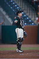Grant Koch (23) of the Greensboro Grasshoppers on defense against the Hickory Crawdads at First National Bank Field on May 6, 2021 in Greensboro, North Carolina. (Brian Westerholt/Four Seam Images)