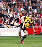 Nederland, Amsterdam, 19 april 2015<br /> Eredivisie<br /> Seizoen 2014-2015<br /> Ajax-NAC Breda (0-0)<br /> Mats Seuntjens van NAC Breda en Joel Veltman van Ajax strijden om de bal