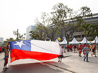 Chile fans hold up a Chilean flag in from of the Maracana stadium