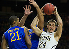 Dec. 7, 2013;  Notre Dame guard Pat Connaughton battles for the rebound against Delaware forward Kyle Anderson (center) as forward Marvin King-Davis looks on in the first half.  Photo by Barbara Johnston/University of Notre Dame