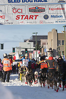 Michi Konno and team leave the ceremonial start line with an Iditarider at 4th Avenue and D street in downtown Anchorage, Alaska on Saturday March 2nd during the 2019 Iditarod race. Photo by Brendan Smith/SchultzPhoto.com