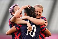 KASHIMA, JAPAN - AUGUST 5: Carli Lloyd #10 of the United States celebrates scoring with Megan Rapinoe #15 and Lindsey Horan #9 during a game between Australia and USWNT at Kashima Soccer Stadium on August 5, 2021 in Kashima, Japan.