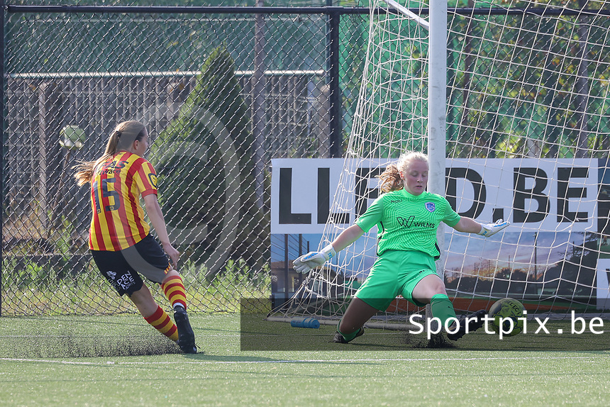 Louisse Rillaerts (15) of Yellow Red KV Mechelen  has an attempt on goal which Goalkeeper Anouk Vereecke (12) of KRC Genk tries to block during soccer game between Yellow Red KV Mechelen Women and KRC Genk during Belgian Women's National Division 1 match  on day 2 of 2021-2022 season, on Saturday 4th of September  2021 in Mechelen , Belgium . PHOTO SEVIL OKTEM | SPORTPIX