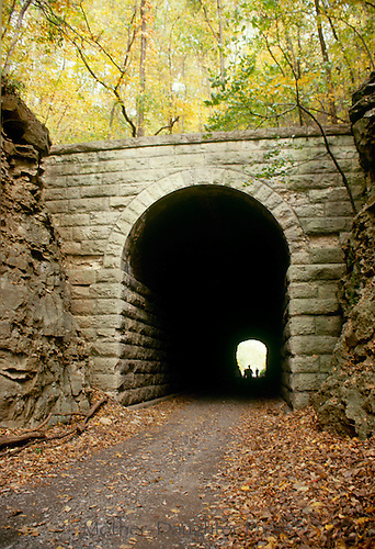 Tunnel through rock bridge on bike path