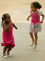 Two girls dance to music played during the annual Fourth of July Celebration and community parade in Birkdale Village in Huntersville, NC. Birkdale Village combines the best of shopping, dining, apartments and entertainment venues within a 52-acre mixed-use development.