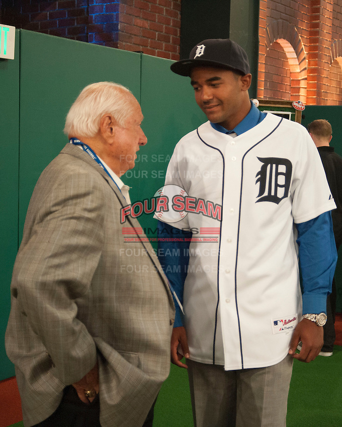 Outfielder Derek Hill (Elk Grove H.S. (CA)) the number 23 overall pick to the Detroit Tigers with Hall of Famer Tommy Lasorda during the MLB Draft on Thursday June 05,2014 at Studio 42 in Secaucus, NJ.   (Tomasso DeRosa/ Four Seam Images)