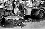 Senior pensioner going shopping Notting Hill west London UK 1975