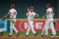 Daniel Lahare (26) of the Louisiana Ragin' Cajuns high fives teammates following their win over the Vanderbilt Commodores in game five of the 2018 Shriners Hospitals for Children College Classic at Minute Maid Park on March 3, 2018 in Houston, Texas.  The Ragin' Cajuns defeated the Commodores 3-0.  (Brian Westerholt/Four Seam Images)