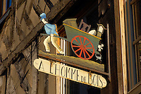 Harbour side restauarants signs - L'homme de Bois. Honfleur, Normandy, France.