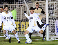 Akron Zips Ben Speas (17) clears a ball from in front of his own goal. The Akron Zips defeated the North Carolina Tar Heals 5-4 in penalty kicks after playing a scoreless game during the second semi-final match of the 2009 NCAA Men's College Cup at WakeMed Soccer Park in Cary, NC on December 11, 2009.