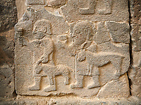 Pictures & images of the South Gate Hittite sculpture stele depicting figures leading goats to sacrifice. 8th century BC. Karatepe Aslantas Open-Air Museum (Karatepe-Aslantaş Açık Hava Müzesi), Osmaniye Province, Turkey.
