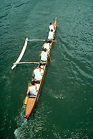 Aerial of outrigger canoers paddling up the Wailua River in Kauai, Hawaii, boat, boats. Hawaiians. Hawaii, Wailua River, Kauai.