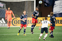 FOXBOROUGH, MA - OCTOBER 19: Andrew Farrell #2 of New England Revolution heads the ball away from the New England goal during a game between Philadelphia Union and New England Revolution at Gillette on October 19, 2020 in Foxborough, Massachusetts.