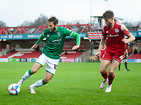 Lincoln City's Jorge Grant under pressure from Accrington Stanley's Cameron Burgess<br /> <br /> Photographer Andrew Vaughan/CameraSport<br /> <br /> The EFL Sky Bet League One - Accrington Stanley v Lincoln City - Saturday 21st November 2020 - Crown Ground - Accrington<br /> <br /> World Copyright © 2020 CameraSport. All rights reserved. 43 Linden Ave. Countesthorpe. Leicester. England. LE8 5PG - Tel: +44 (0) 116 277 4147 - admin@camerasport.com - www.camerasport.com