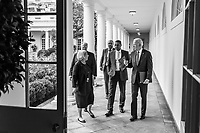 President Joe Biden walks with staff along the Colonnade of the White House, Friday, July 2, 2021, en route to greet the 2020 Baseball World Series Champions, the Los Angeles Dodgers. (Official White House Photo by Adam Schultz)