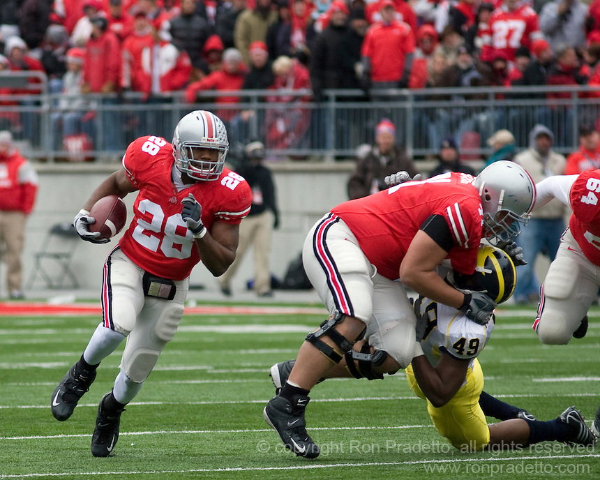 """November 22, 2008. Ohio State running back Chris """"Beanie Wells (28) follows a block by left guard Steve Rehring. The Ohio State Buckeyes defeated the Michigan Wolverines 42-7 on November 22, 2008 at Ohio Stadium, Columbus, Ohio."""