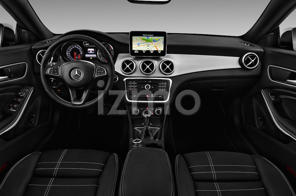 Stock photo of straight dashboard view of 2016 Mercedes Benz CLA - 4 Door Sedan Dashboard