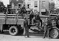 Photo from the NIOD's Huizinga collection. After their surrender, German soldiers wait at the moment of departure with their fully loaded truck.