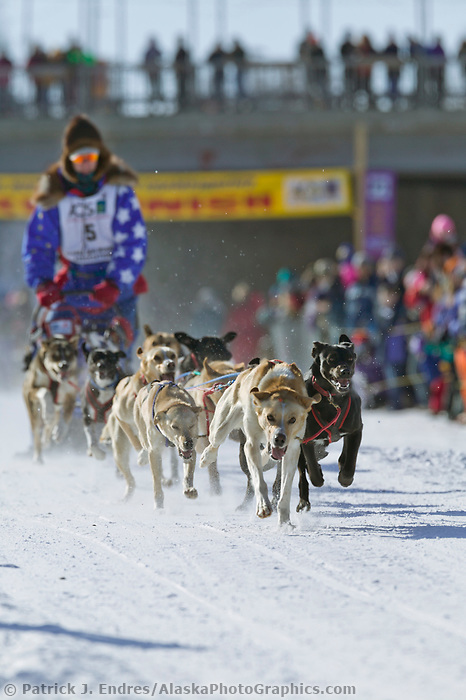 Arleigh Reynolds at the start of day three of the oldest continuously run sled dog race in the world, the 2003 Open North American Sled dog championships which start on the Chena River in downtown Fairbanks, Alaska. The annual race consists of three daily races, the combined fastest time wins.