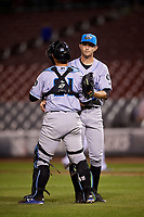 Hudson Valley Renegades relief pitcher Alan Strong (28) celebrates with catcher Erik Ostberg (21) after a game against the Connecticut Tigers on August 20, 2018 at Dodd Stadium in Norwich, Connecticut.  Hudson Valley defeated Connecticut 3-1.  (Mike Janes/Four Seam Images)