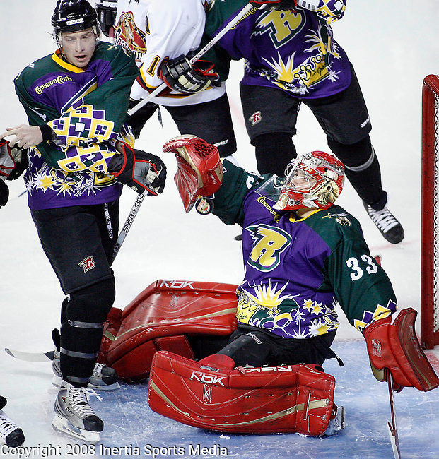 RAPID CITY, SD - JANUARY 17 --  Rapid City Rush goalie Miguel Beaudry #33 eyes the puck as teammate Derek LeBlanc tries to help protect the goal in the first period of their game against the New Mexico Scorpions Saturday evening at the Rushmore Plaza Civic Center Ice Arena. (Photo by Dick Carlson/Inertia)