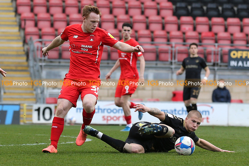 Danny Johnson of Leyton Orient and Harry Clarke of Oldham Athletic during Leyton Orient vs Oldham Athletic, Sky Bet EFL League 2 Football at The Breyer Group Stadium on 27th March 2021