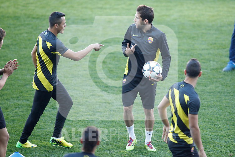 FC Barcelona´s Alexis and Jordi Alba during a training at the Vicente Calderon stadium in Madrid, Spain. Atletico de Madrid will face FC Barcelona in the second leg quarterfinal Champions League soccer match.  April 8, 2014. (ALTERPHOTOS/Victor Blanco)