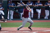 Justin Rouse (19) of the Bellarmine Knights follows through on his swing against the Liberty Flames at Liberty Baseball Stadium on March 9, 2021 in Lynchburg, VA. (Brian Westerholt/Four Seam Images)