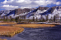 """Three of the four """"brothers"""" along the Madison River, close to Madison Junction in Yellowstone. An early snowfall helps to encourage the spawning brown trout on and fishing in Yellowstone is often at its finest."""