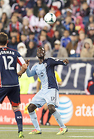 Sporting Kansas City forward C.J. Sapong (17) gauges a head ball. In the first game of two-game aggregate total goals Major League Soccer (MLS) Eastern Conference Semifinal series, New England Revolution (dark blue) vs Sporting Kansas City (light blue), 2-1, at Gillette Stadium on November 2, 2013.