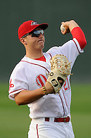 Outfielder Nick Longhi (21) of the Greenville Drive warms up before a game against the Lexington Legends on Tuesday, April 14, 2015, at Fluor Field at the West End in Greenville, South Carolina. Lexington won, 5-3. (Tom Priddy/Four Seam Images)