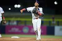 Kannapolis Cannon Ballers shortstop Jose Rodriguez (12) makes a throw to first base against the Charleston RiverDogs at Atrium Health Ballpark on June 30, 2021 in Kannapolis, North Carolina. (Brian Westerholt/Four Seam Images)