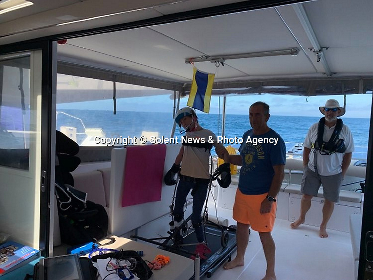 Pictured:  Natasha Lambert onboard her boat Blown Away which is the catamaran she used for the challenge.  She is pictured with her dad Gary<br /> <br /> A young woman with cerebral palsy has sailed 3,000 miles across the Atlantic ocean in just 18 days - using only her mouth and tongue to control the boat.<br /> <br /> Natasha Lambert, 23, used the 'sip and puff' system engineered by her electrician father to sail from Gran Canaria on the Western coast of Africa to St Lucia in the Caribbean.<br /> <br /> The trip, which hoped to raise £30,000 for three charities, took 18 days, 24 hours, 29 minutes and eight seconds to complete.   SEE OUR COPY FOR DETAILS.<br /> <br /> © Solent News & Photo Agency<br /> UK +44 (0) 2380 458800