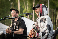 John Gourley and Eric Howk of Grammy-winning Alaskan rock band Portugal. The Man as they perform at a rally to override the governor's vetoes at the Alaska Airlines Center.