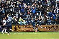 KANSAS CITY, KS - MAY 16: Sporting KC players and fans celebrate their opening goal during a game between Vancouver Whitecaps and Sporting Kansas City at Children's Mercy Park on May 16, 2021 in Kansas City, Kansas.
