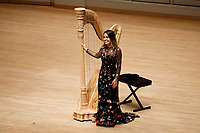Harpist Katherine Siochi stands as the audience applauds during her laureate recital at the 11th USA International Harp Competition at Indiana University in Bloomington, Indiana on Friday, July 5, 2019. (Photo by James Brosher)
