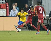 Portugal midfielder Ruben Amorim (20) tackles Brazil forward Neymar (10).  In an International friendly match Brazil defeated Portugal, 3-1, at Gillette Stadium on Sep 10, 2013.